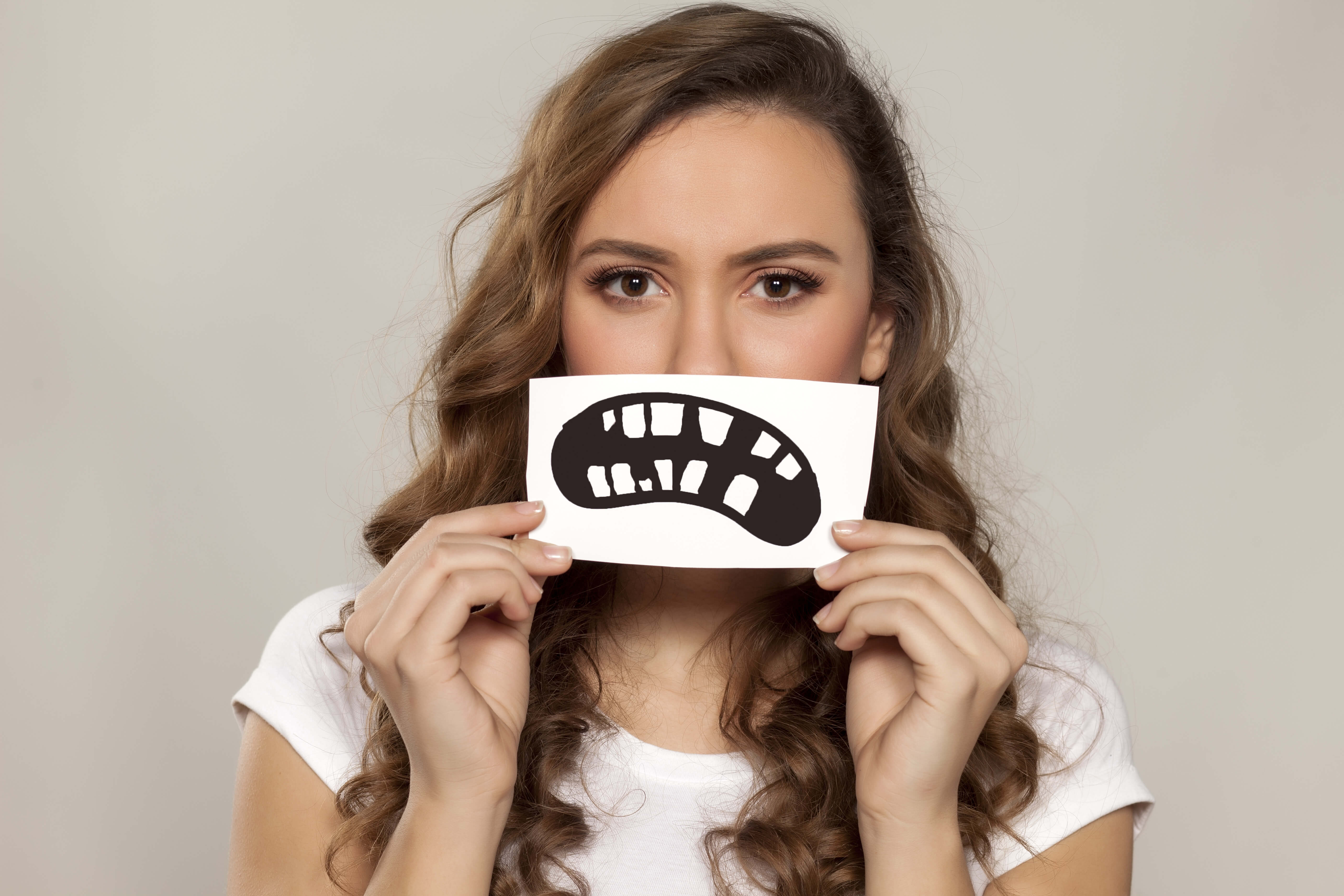 fix your crooked teeth by wearing braces or a retainer or invisalign